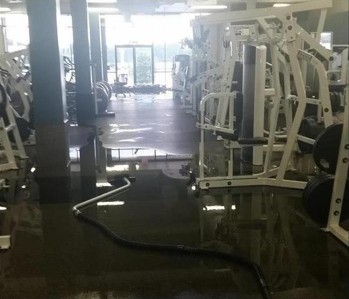 flooding water on floor with gym equipment